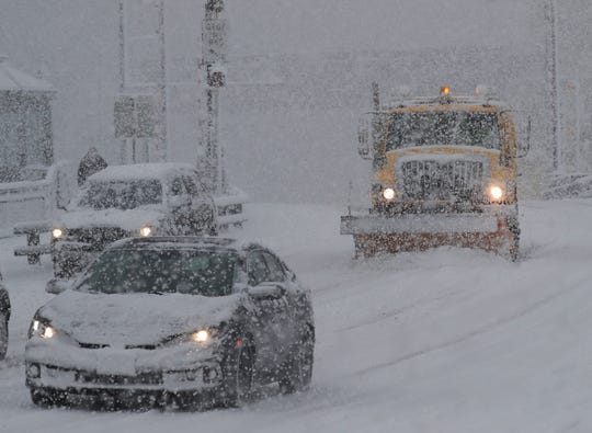 A City of Milwaukee snow plow clears West State Street near North Old World Third Street.