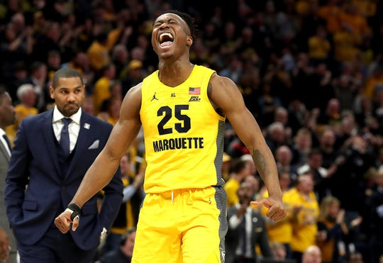 Marquette guard Koby McEwen is pumped up after connecting on a three-pointer against Butler.