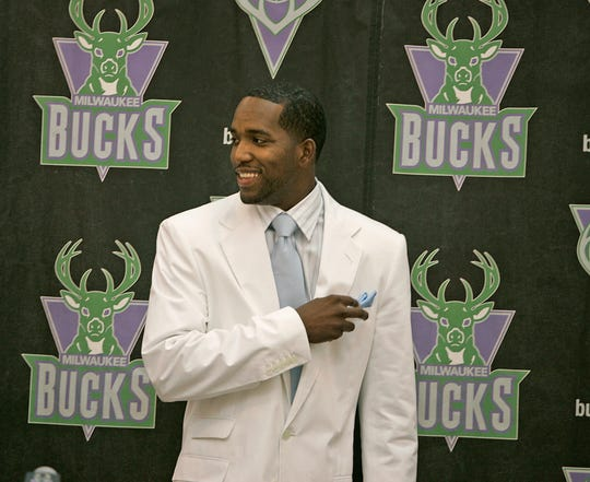 Michael Redd is all smiles as he takes his seat at a press conference Saturday, August 13, 2005., at the Cousins Center in Milwaukee where The Milwaukee Bucks announced the guard's signing of a multi-year contract.