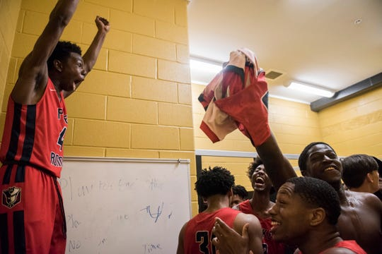 Pike Road players celebrate in their locker room after the game during the Class 3A, Area 5 boys championship at Bullock County High School in Union Springs, Ala., on Saturday, Feb. 8, 2020. Pike Road defeated Bullock County 51-48.