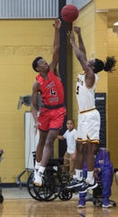 Pike Road's Jaylen Washington (4) blocks Bullock County's shot late in the game during the Class 3A, Area 5 boys championship at Bullock County High School in Union Springs, Ala., on Saturday, Feb. 8, 2020. Pike Road defeated Bullock County 51-48.