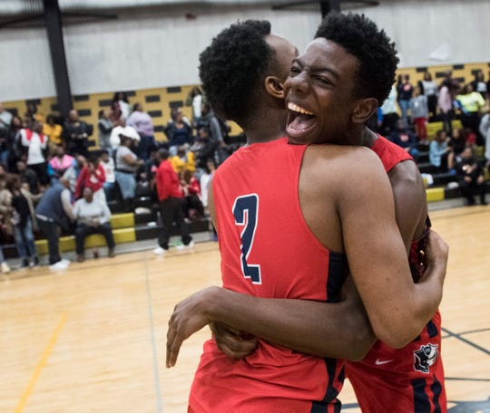 Pike Road's Jaylen Washington (4) and Brandon Glasco (2) celebrate after the game during the Class 3A, Area 5 boys championship at Bullock County High School in Union Springs, Ala., on Saturday, Feb. 8, 2020. Pike Road defeated Bullock County 51-48.