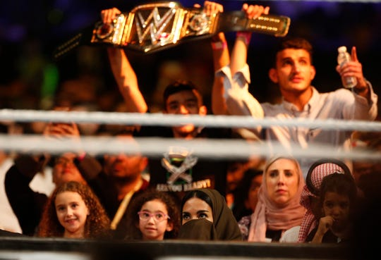 "Saudi wrestling fans watch the World Wrestling Entertainment ""WWE"" stars during Crown Jewel matches at King Fahd International Stadium in Riyadh, Saudi Arabia, Thursday, Oct. 31, 2019. (AP Photo/Amr Nabil)"