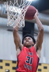 Pike Road's Tre Wallace (31) dunks the ball during the Class 3A, Area 5 boys championship at Bullock County High School in Union Springs, Ala., on Saturday, Feb. 8, 2020. Pike Road defeated Bullock County 51-48.