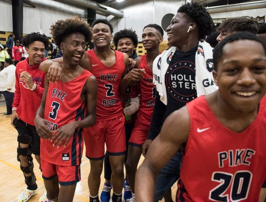 Pike Road players celebrate after the game during the Class 3A, Area 5 boys championship at Bullock County High School in Union Springs, Ala., on Saturday, Feb. 8, 2020. Pike Road defeated Bullock County 51-48.