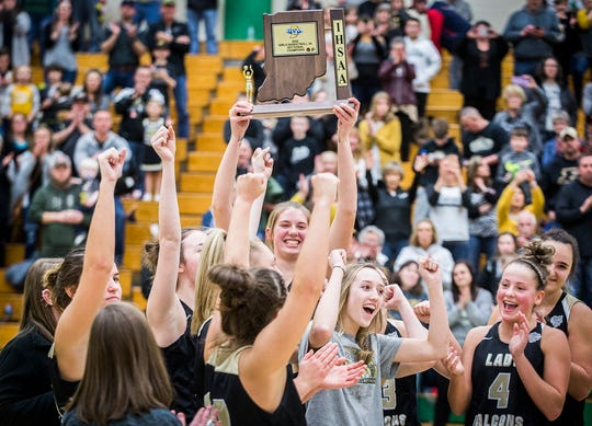 Winchester celebrates defeating Yorktown in their sectional championship game at Yorktown High School Saturday, Feb. 8, 2020.