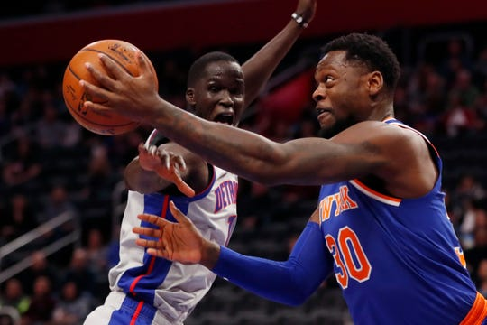 New York Knicks forward Julius Randle (30) passes as Detroit Pistons forward Thon Maker (7) defends during the first half of an NBA basketball game, Saturday, Feb. 8, 2020, in Detroit.