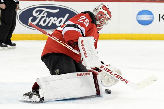 New Jersey Devils goaltender Mackenzie Blackwood (29) stops the puck during the first period of an NHL hockey game against the Los Angeles Kings, Saturday, Feb. 8, 2020, in Newark, N.J.