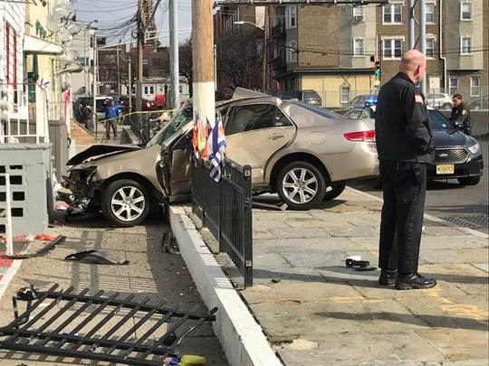 A car hit a telephone pole at the Mill Street grocery on Oliver Street in Paterson on Sunday afternoon. The driver was taken to St.Joseph's hospital with injuries that were described as 'life threatening.'