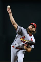 Sep 25, 2019; Phoenix, AZ, USA; St. Louis Cardinals starting pitcher Michael Wacha (52) pitches against the Arizona Diamondbacks during the first inning at Chase Field. Mandatory Credit: Joe Camporeale-USA TODAY Sports