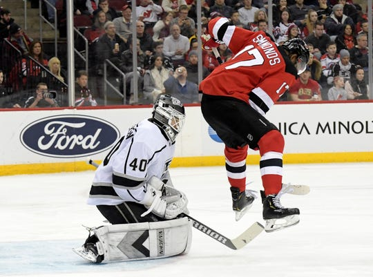 Los Angeles Kings goaltender Calvin Petersen (40) gloves the puck as he is screened by New Jersey Devils right wing Wayne Simmonds (17) during the second period of an NHL hockey game Saturday, Feb. 8, 2020, in Newark, N.J.