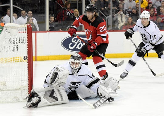 Los Angeles Kings goaltender Calvin Petersen (40), defenseman Ben Hutton (15) and New Jersey Devils center Blake Coleman (20) watch the puck go into the net for a goal by Devils' Nikita Gusev (not shown) during the second period of an NHL hockey game Saturday, Feb. 8, 2020, in Newark, N.J.
