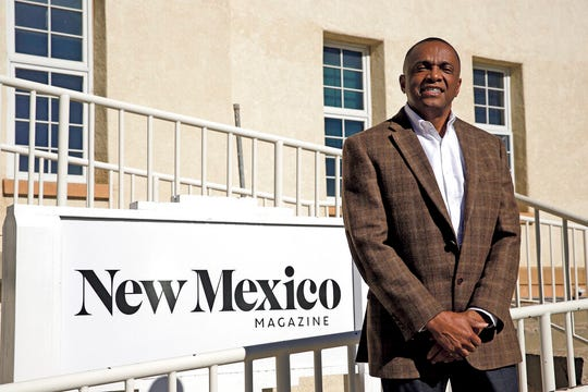 In this Tuesday, Jan. 28, 2020, photo, Edward Graves, the new CEO/publisher of New Mexico Magazine, poses for a portrait outside the magazine's office in the Lew Wallace building in Santa Fe, N.M.