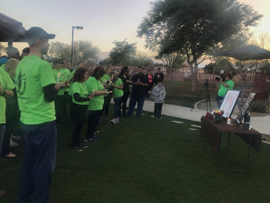 Friends and family gather Saturday, Feb. 8, 2020 for a vigil for Rebecca Modrall. The Rancho Mirage woman has been missing for a year and her disappearance is being investigated as a homicide.