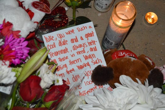 A memorial was started near the site of the crash with flowers, notes and candles from friends.