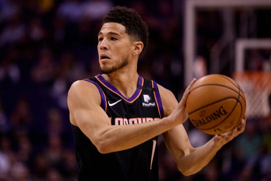 Feb 8, 2020; Phoenix, Arizona, USA; Phoenix Suns guard Devin Booker (1) handles the ball in the first half against the Denver Nuggets at Talking Stick Resort Arena. Mandatory Credit: Jennifer Stewart-USA TODAY Sports