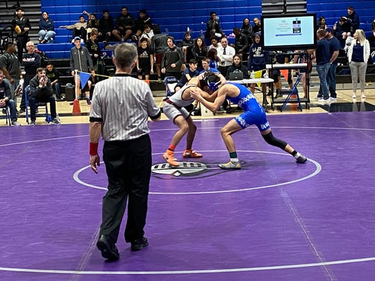 Feb. 8, 2020; Chandler boys wrestler Gabriel Fuentas tries to overpower Hamilton's Issac Grier in Round 1 of the Division I, Section I wrestling tournament at Chandler High School.