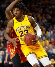 ASU's Romello White (23) drives in the paint against USC's Onyeka Okongwu (21) during the first half at Desert Financial Arena in Tempe, Ariz. on Feb. 2, 2020.