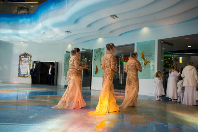 Greeters enter La Luz del Mundo during its opening service after more than a decade of construction Sunday, Feb. 9, 2020 in Phoenix.