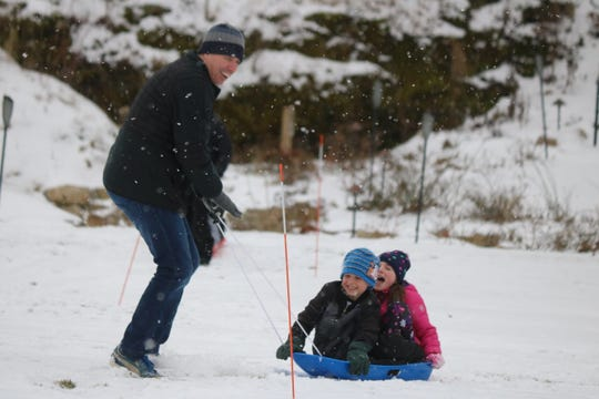 The Borys family, of Medina, compete in a sled pulling race at Twin Oast during their Winter Fest on Saturday.