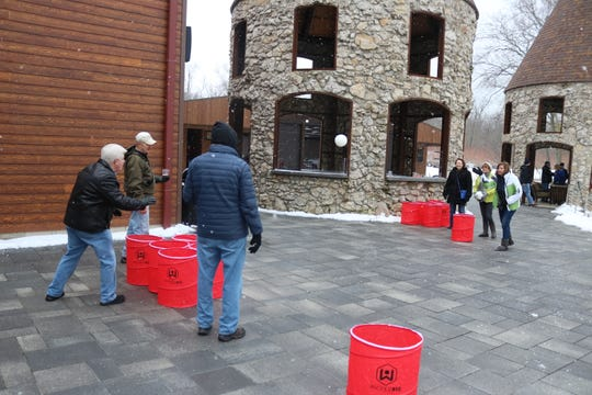 "A group of Winter Fest attendees play a game of ""giant pong"" at Twin Oast on Saturday."
