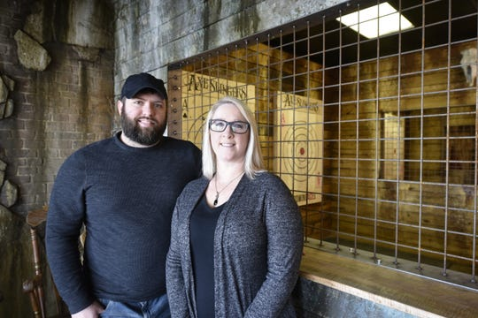 Riley Cameron and Tia Hixon are the owners of Axe Slingers. Pictured Saturday, Feb. 8, 2020.