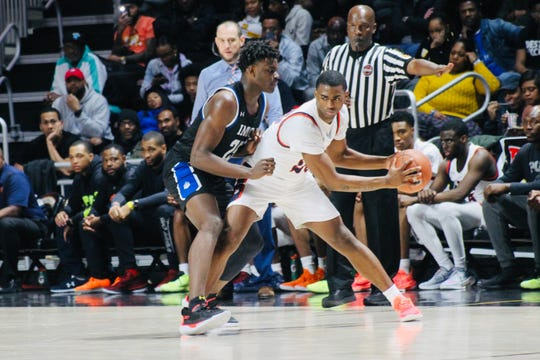 IMG Academy sophomore Jarace Walker, left, defends a Poly Tech player at UMBC Event Center on Saturday. Walker, a New Freedom, Pennsylvania, native, transferred to elite Florida-based program last season.