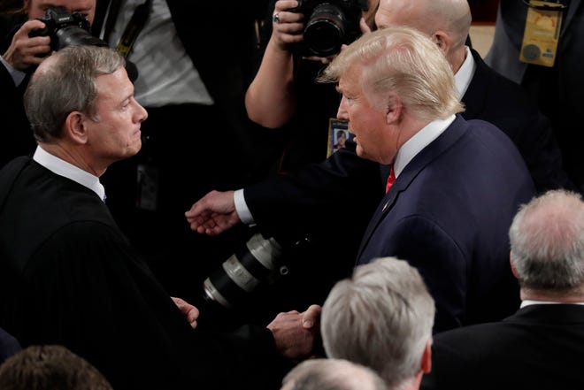 U.S. President Donald Trump shakes hands with Supreme Court Chief Justice John Roberts as he arrives to deliver his State of the Union address on Capitol Hill on Tuesday, Feb. 4, 2020 in Washington, D.C. (Yuri Gripas/Abaca Press/TNS)
