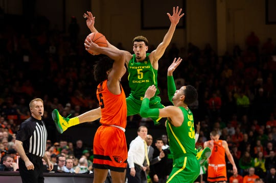 Feb 8, 2020 Corvallis, Oregon, USA; Oregon State Beavers guard Ethan Thompson (5) is double teamed by Oregon Ducks guard Chris Duarte (5) and guard Anthony Mathis (32) during the first half at Gill Coliseum. Mandatory Credit: Troy Wayrynen-USA TODAY Sports