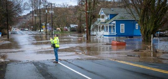 Touchet River water flows across Highway 12, closing it, on the east side of Waitsburg, Washington, on Friday, Feb. 7, 2020. (Greg Lehman/Walla Walla Union-Bulletin via AP)