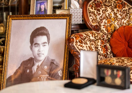 Julio Sorio's portrait as a young scout is seen on the left side of the frame. Sorio was given the highest civilian honor in U.S. Congress on Saturday, Feb. 8, 2020. The Congressional Gold Medal lies down next to other medals that Sorio has received for the time he spent serving in World War II.