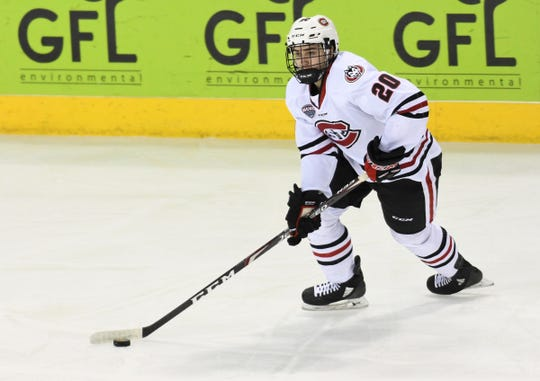 St. Cloud State sophomore Nolan Walker skates with the puck Saturday, Feb. 8, 2020, at Colorado College.