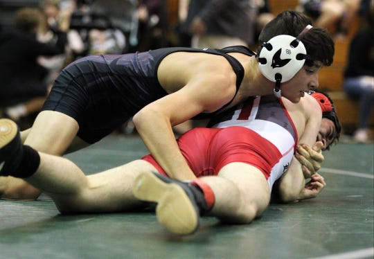 Chiles sophomore Hunter Brown wrestles Leon as the Timberwolves won all five matches and captured the team victory during the Timberwolf Duals on Feb. 8, 2020.