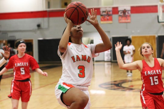 FAMU DRS senior Ashley Reddick goes up for a fastbreak layup as the Rattlers' girls basketball team beat NFC 59-22 in the District 1-2A final on Feb. 8, 2020.