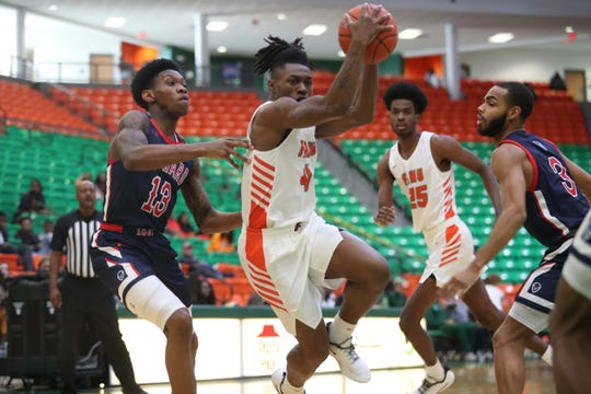 FAMU guard Rod Melton drives hard to the basket against Howard. He scored 11 points in the team's 82-78 win in overtime versus the Bison on Saturday, Feb. 8, 2020.
