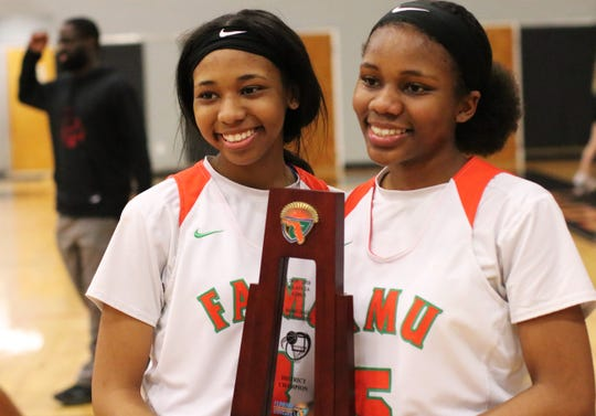 FAMU DRS senior Ashley Reddick and sophomore sister Alexandria Reddick celebrate as the Rattlers' girls basketball team beat NFC 59-22 in the District 1-2A final on Feb. 8, 2020.