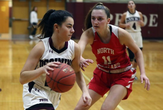 Ossining's Julia Ioroi (22) drives to the basket in front of North Rockland's Grace Mallozzi (11) during the final game of the Pauline Ricci Memorial Classic at Ossining High School Feb. 8, 2020. Ossining won the game 80-54.