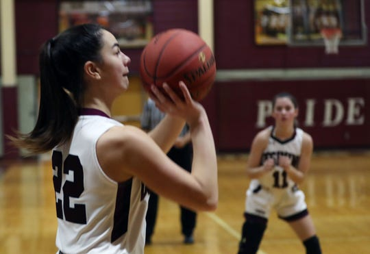 Ossining's Julia Ioroi (22) puts up a shot  against North Rockland during the final game of the Pauline Ricci Memorial Classic at Ossining High School Feb. 8, 2020. Ossining won the game 80-54.