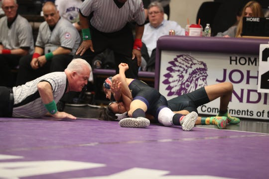 Action during the divisional wrestling tournament at John Jay High School in Cross River Feb. 8, 2020.