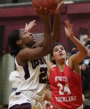 Ossining's Ede Walker (20) drives to the basket in front of North Rockland's Alana Melendez (24) during the final game of the Pauline Ricci Memorial Classic at Ossining High School Feb. 8, 2020. Ossining won the game 80-54.