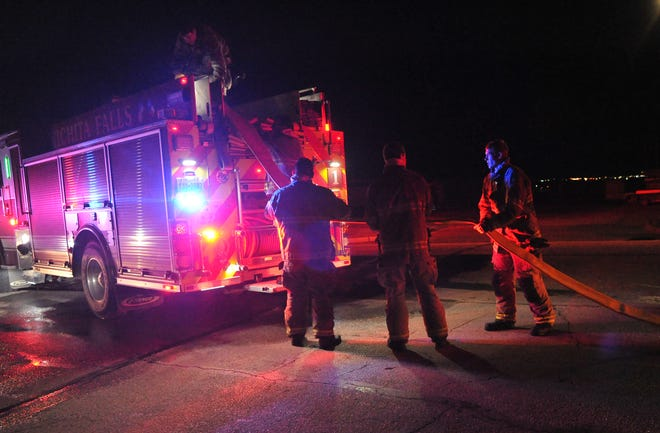 Wichita Falls firefighters work to control a late Saturday night fire.