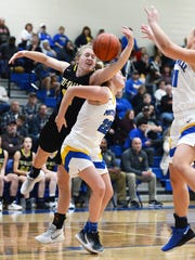 Audrey Spiker, of Tri-Valley, left, and Maysville's Macie Jarrett fight for a rebound during the second half of the Scotties' 54-45 win on Saturday night in Newton Township.