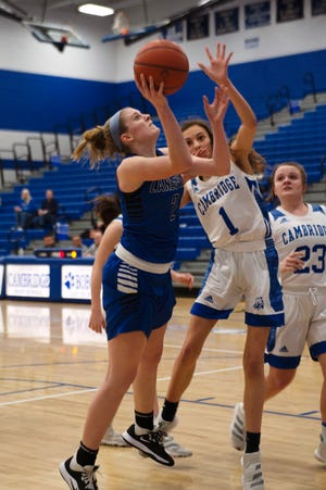 Zanesville's Maddy Winland goes up for a shot against a Cambridge defender in Saturday's 32-24 win.