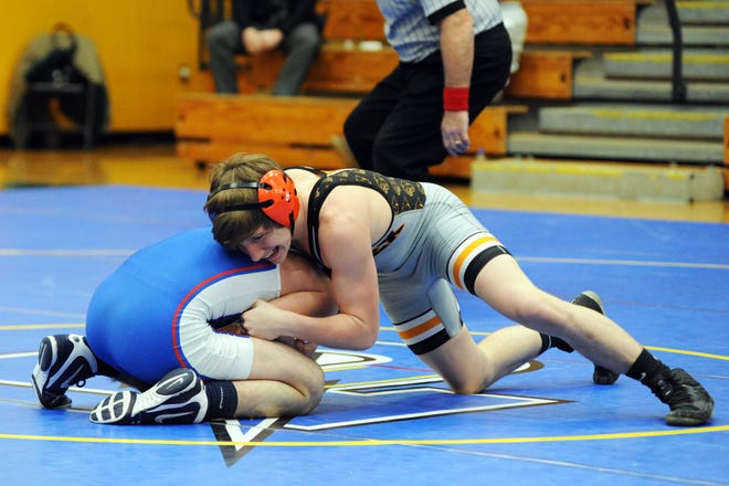 New Lexington's Kody Beal wrestles West Holmes' Kendel Weber in the Division II regional final of the state dual tournament on Saturday at Philo.