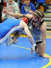 New Lexington's Blake Sheppard wrestles West Holmes' Tyler Masters in the Division II regional final of the state dual tournament on Saturday at Philo.