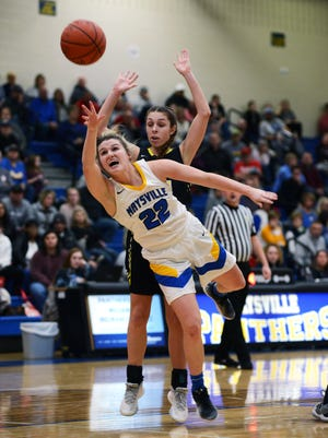 Macie Jarrett, of Maysville, goes up for a shot against Tri-Valley's Lauren King during the second quarter on Saturday night in Newton Township. Tri-Valley won, 54-45, to clinch a share of the Muskingum Valley League title.