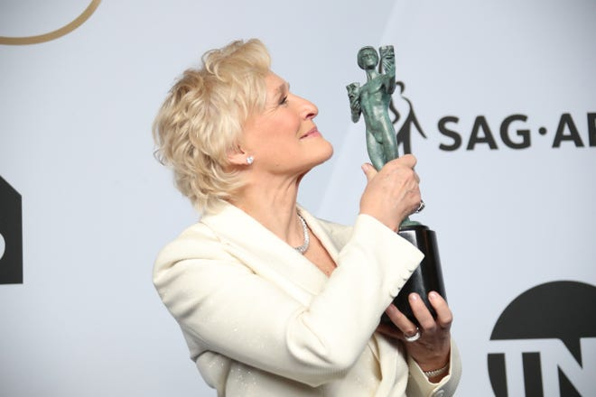 "Glenn Close poses with her SAG Award for ""The Wife"" in 2019. Close is nominated for supporting actress for ""Hillbilly Elegy"" along with Yuh-jung Youn for ""Minari,"" Soonja Maria Bakalova in ""Borat Subsequent Moviefilm,"" Olivia Colman in ""The Father"" and Helena Zengel in ""News of the World."""