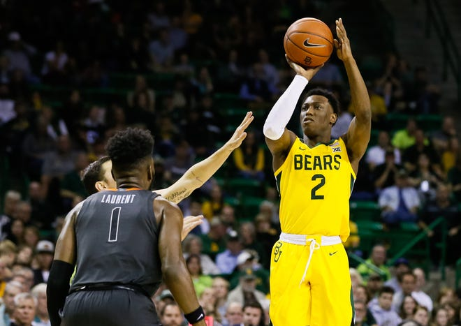 Baylor guard Devonte Bandoo (2) shoots a three-pointer against Oklahoma State defense during the second half.
