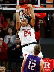 Rutgers Scarlet Knights guard Ron Harper Jr. (24) dunks against Northwestern Wildcats guard Pat Spencer (12)