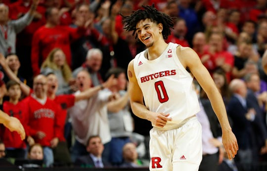 Rutgers Scarlet Knights guard Geo Baker (0) smiles after making a three point shot against the Northwestern Wildcats